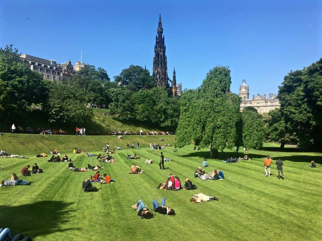 Princes Street Gardens Edinburgh people lying in the sunshine