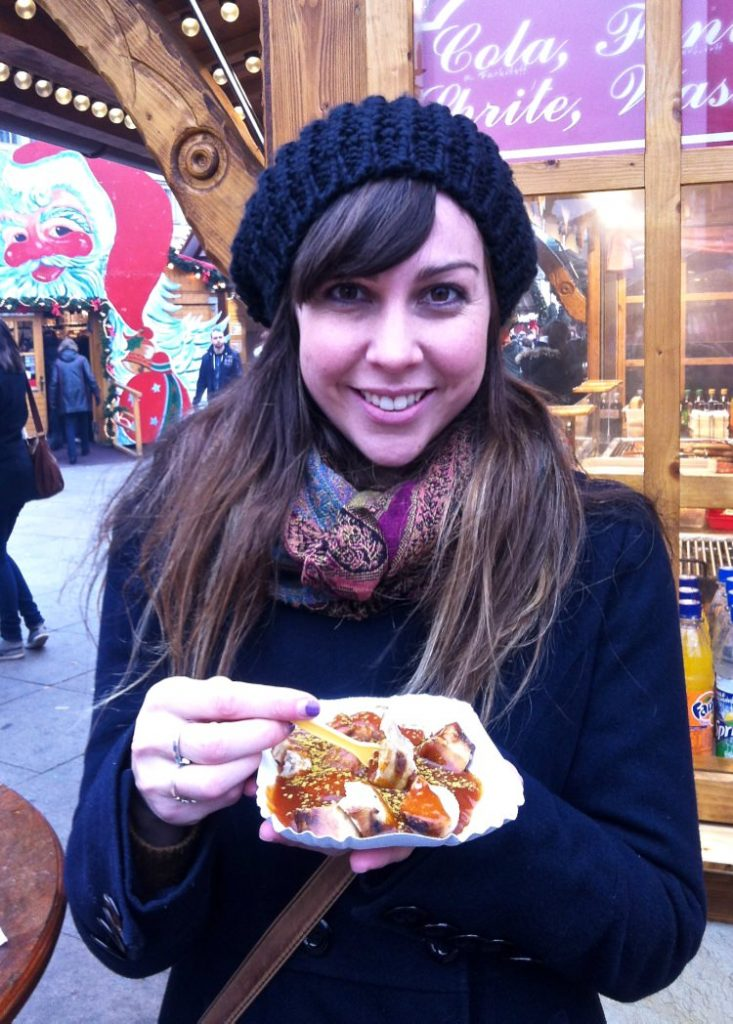 Eating Currywurst at Berlin Christmas Market