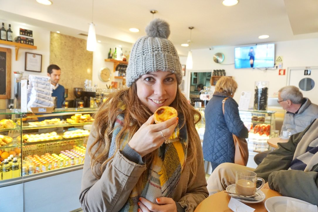 Eating an egg tart in a bakery in Portugal