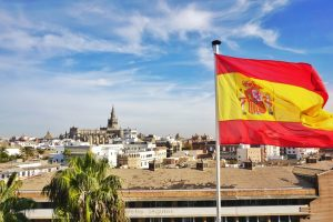 Spain in winter - Seville skyline and Spanish flag