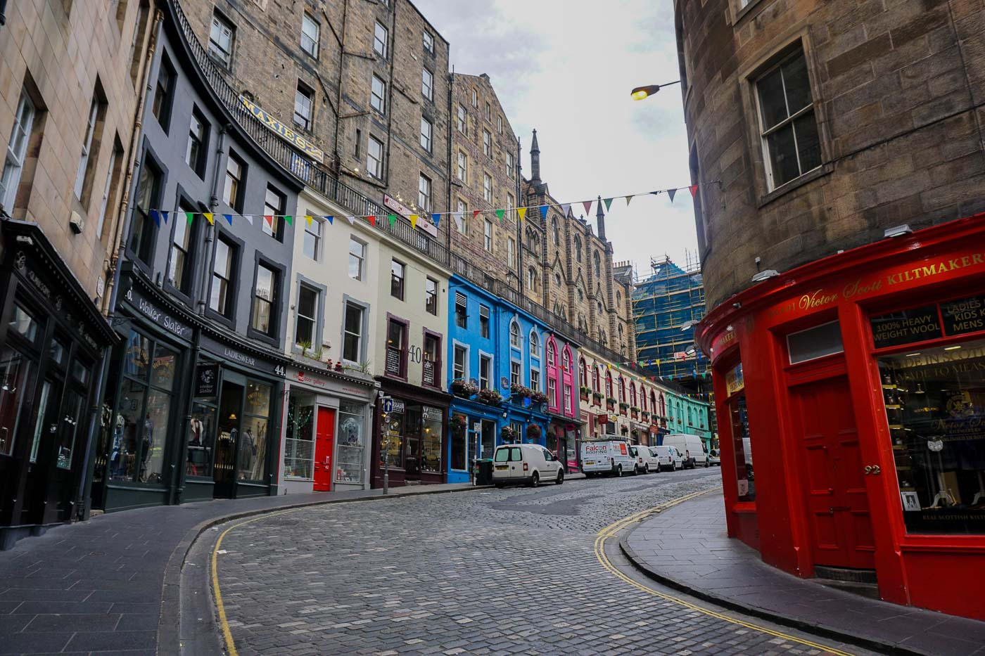 Curving street with colourful shop fronts