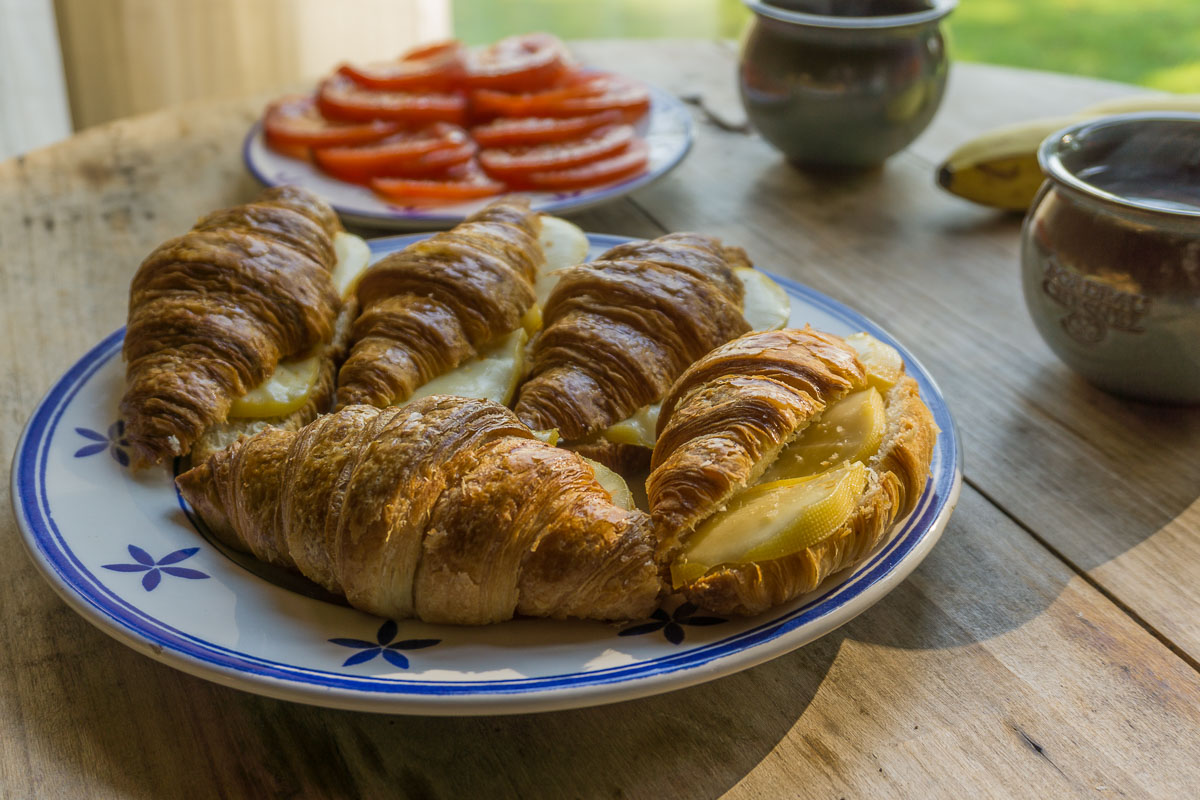Couples Budget Travel - Cook your own food croissants and tomatos