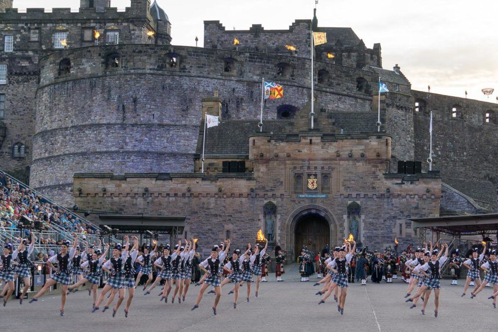 Edinburgh Festivals August - Edinburgh Tattoo pipe bands and dancers in front of Edinburgh Castle