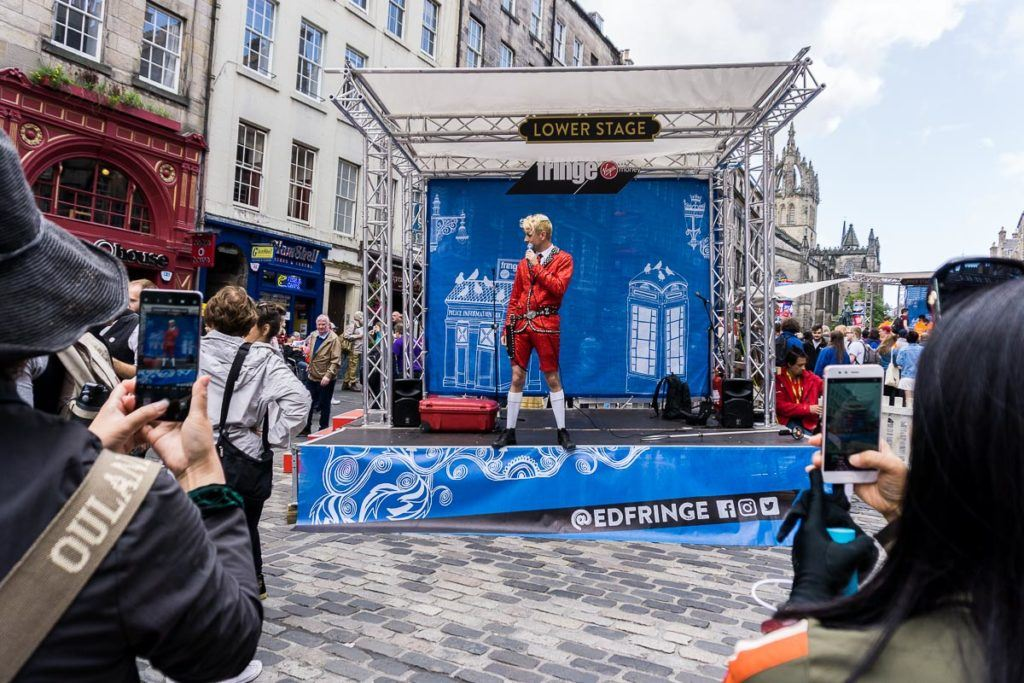 Edinburgh Festivals August - Fringe Festival on Royal Mile small stage performer