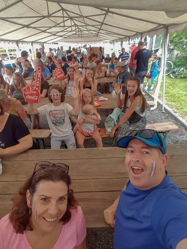 Villagers watching France win the 2018 Football World Cup