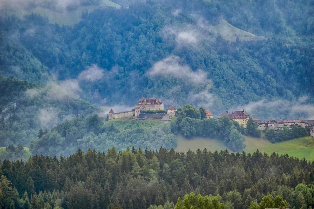 Gruyeres Castle in Misty Mountains: Beautiful Places in Switzerland