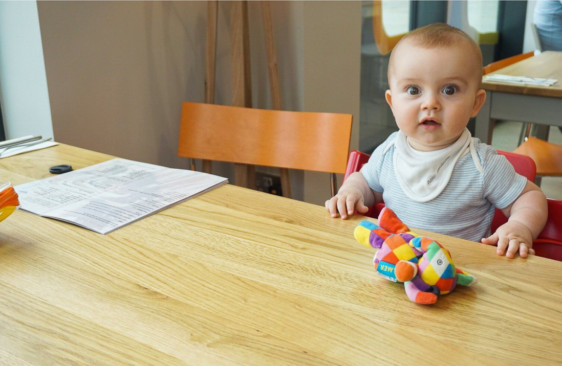 Baby at cafe table