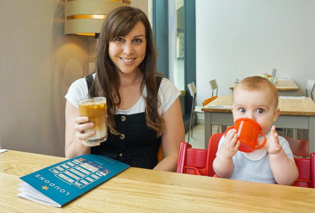 Baby Friendly Edinburgh Cafe: Mum with iced coffee and baby with sippy cup at table