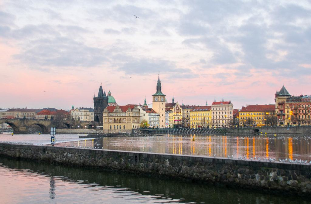 Babymoon Destinations Europe-Prague Czech Republic - View of city skyline across the river at sunset