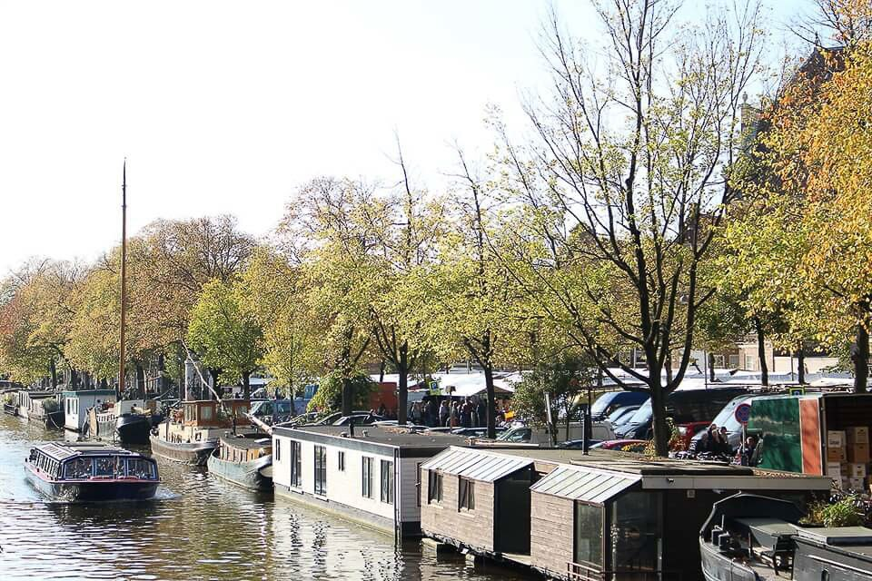 Babymoon Destinations Europe-Prinsengracht in Autumn - Amsterdam in Autumn boat on canal with trees