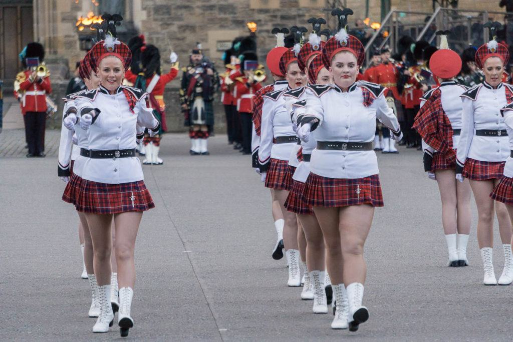 Edinburgh Military Tattoo - Marching Girls in lines in front of Edinburgh Castle and military band
