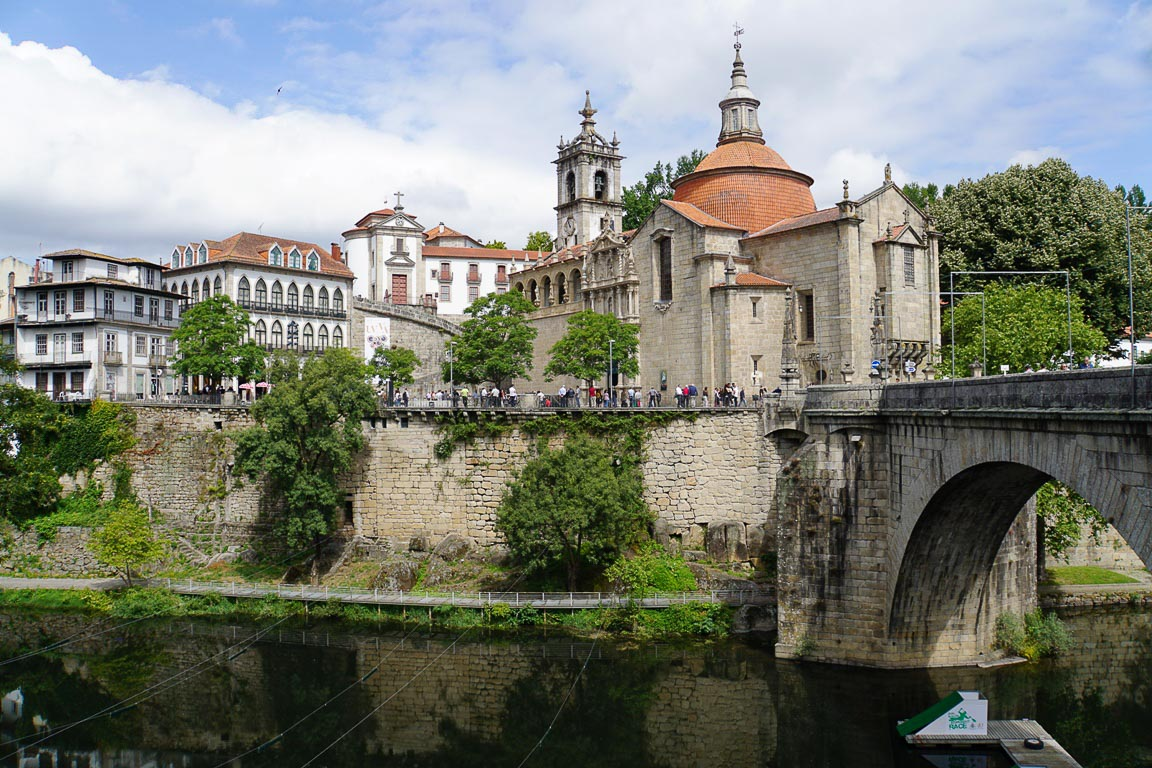 Historic Buildings by river and bridge in town