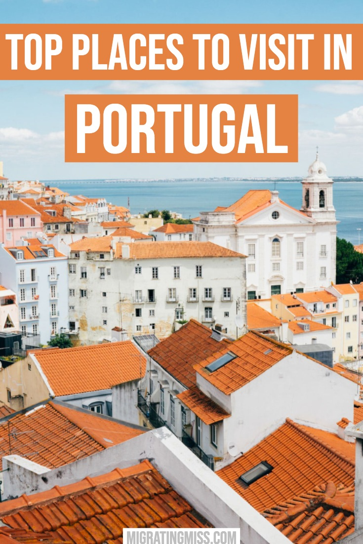Best Places to Visit in Portugal - orange roofs and whitewashed buildings in a city.