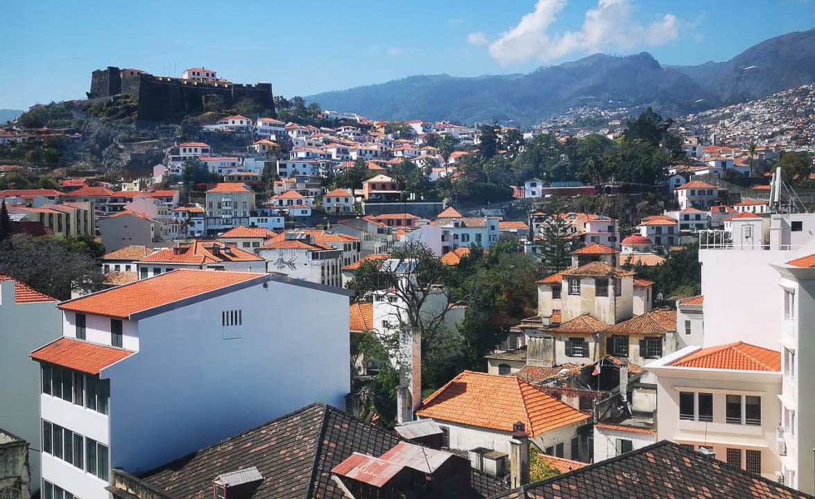 Town in Madeira with white houses and orange rooves.