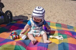 Baby on mat at the beach