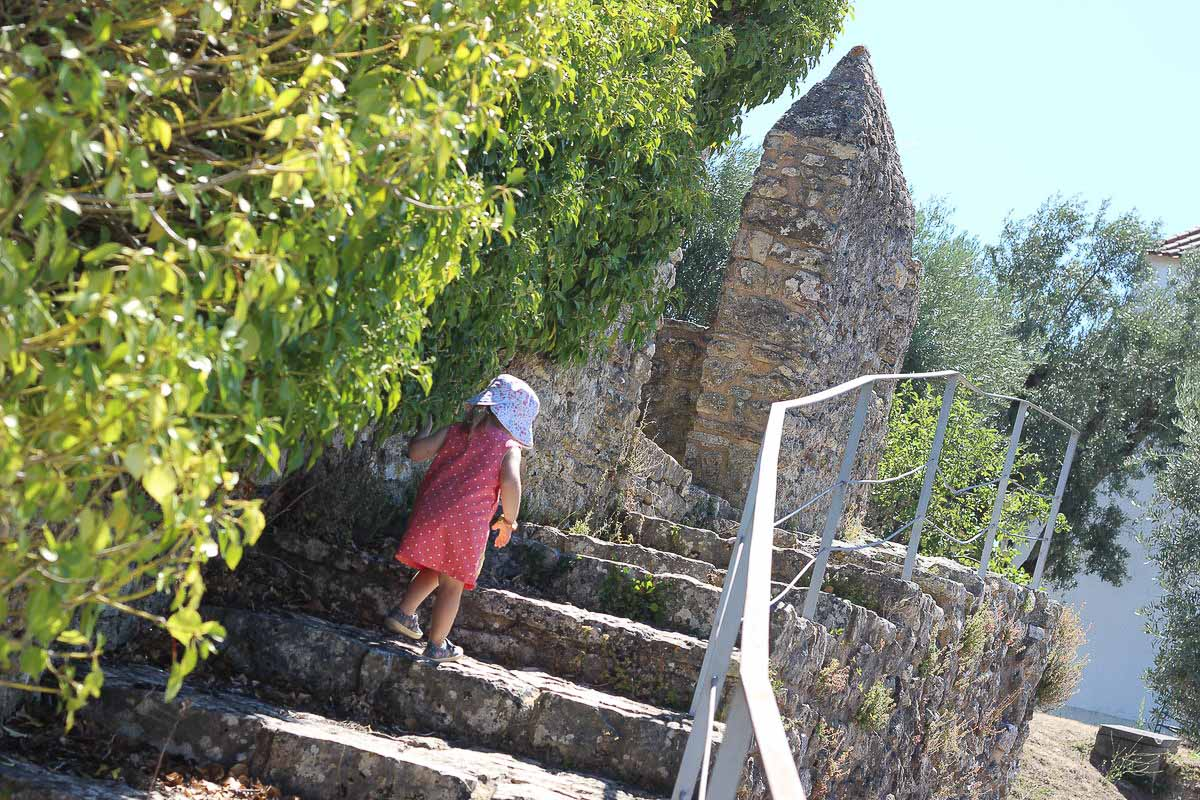 Child going up stone stairs outside