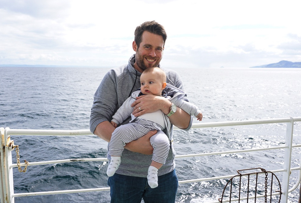 Baby and Dad on a ferry on the way to Isle of Arran