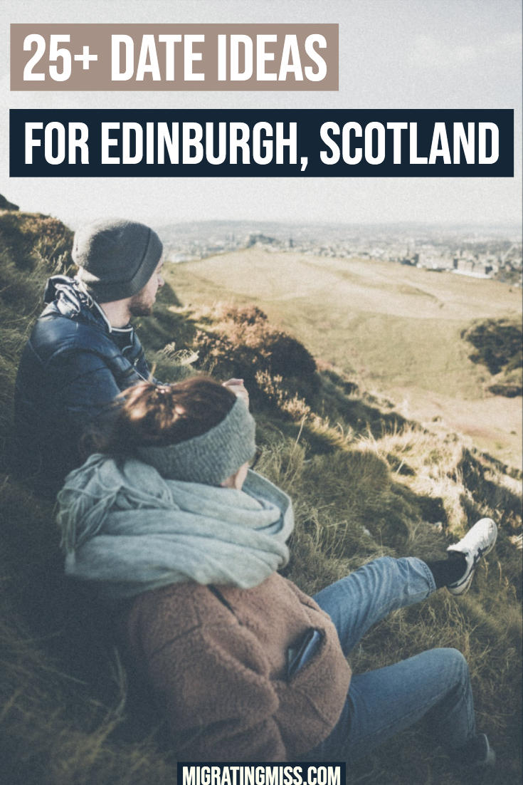 Couple up hill overlooking Edinburgh