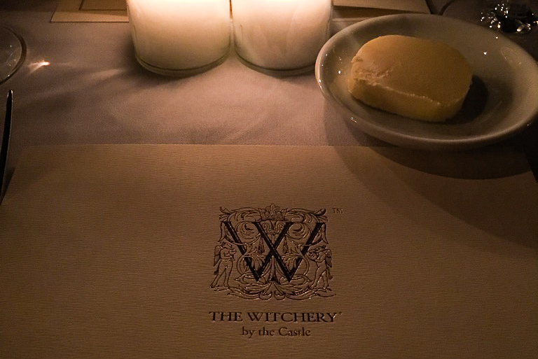 Menu and candles at The Witchery restaurant