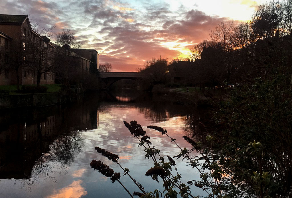 Sunset on the water of Leith in Edinburgh in February