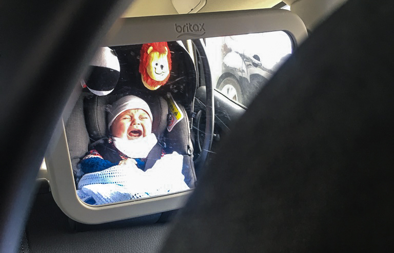 Baby crying in car seat on road trip