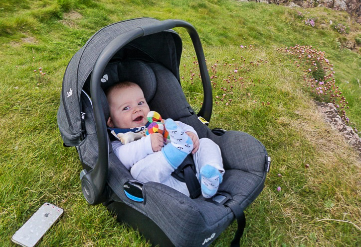 Baby in car seat on grass