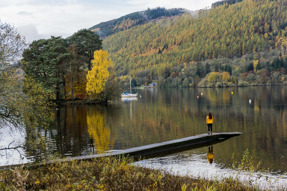 Person on dock overlooking Loch Tay