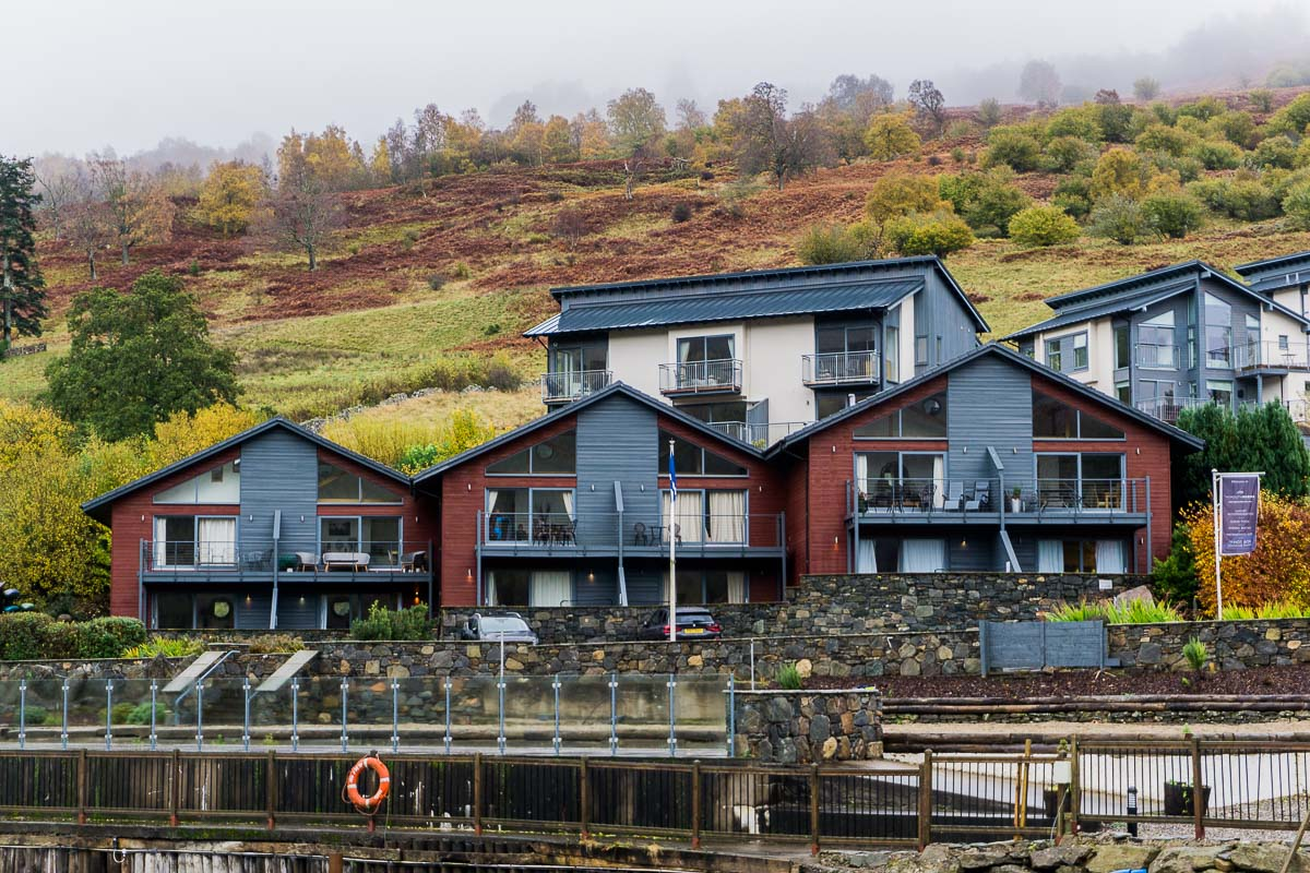 Apartments at the foot of hills next to loch