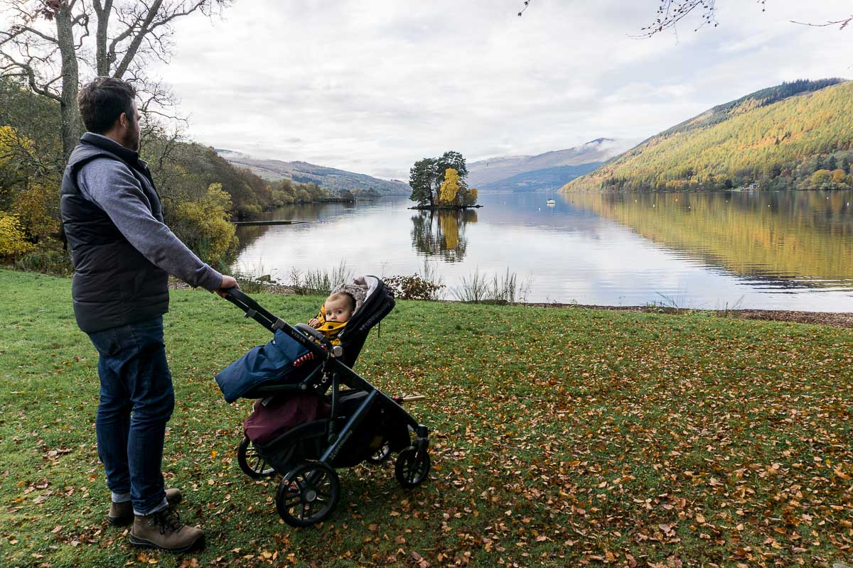 Dad and baby in pram overlooking Loch Tay Scotland