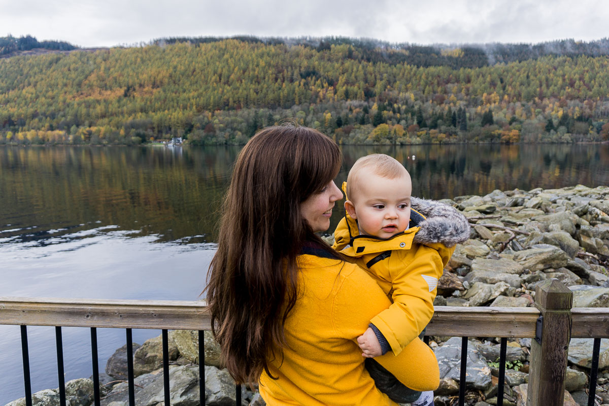 Mum and baby overlooking loch at Taymouth Marina Loch Tay