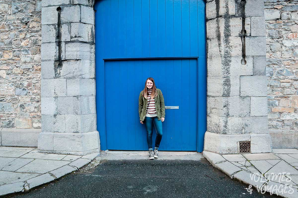 Moving to Dublin - Woman standing infront of large gate in Dublin