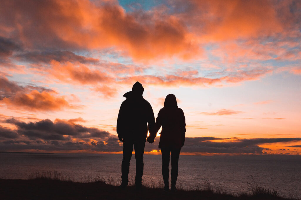 Romantic Places in the USA - Couple watching sunset