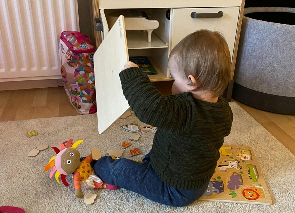 Working from home with a toddler - set up activity stations - baby with puzzle
