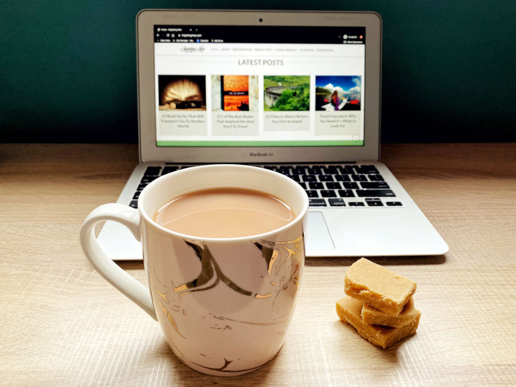 Laptop with cup of tea and tablet working from home tips