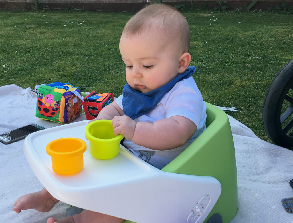 Best Travel High Chairs - Baby in bumbo seat outside