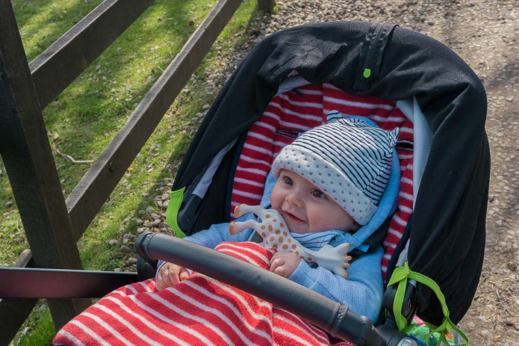 Baby in a buggy- Places to stay in Scotland with kids
