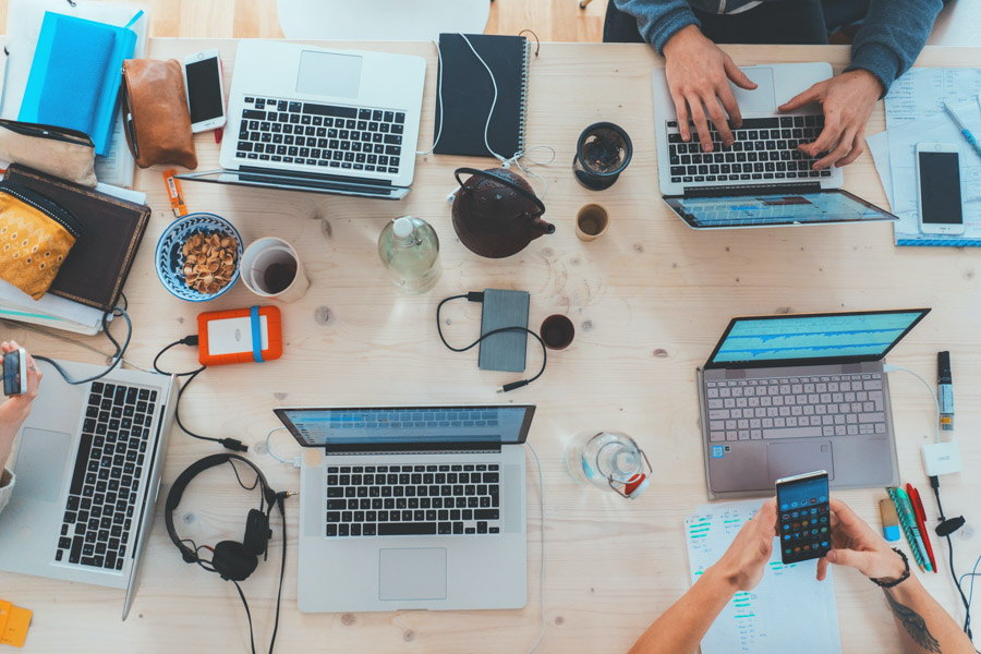 Social media Tips for Bloggers - Laptops around a table