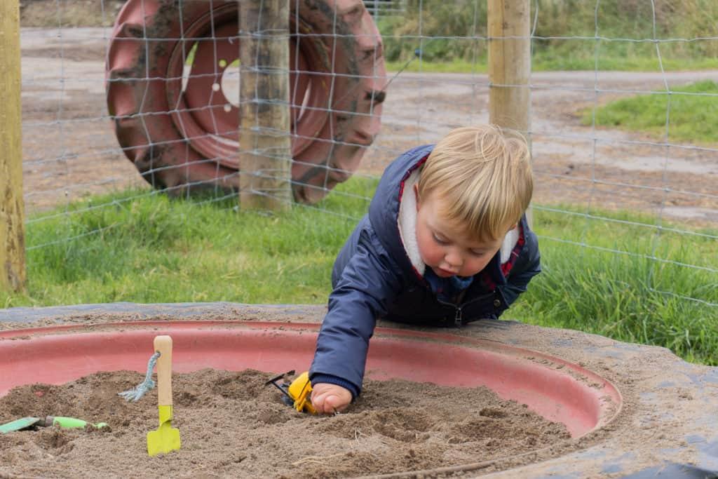 Jacksons at Jedburgh - Toddler playing in sandpit