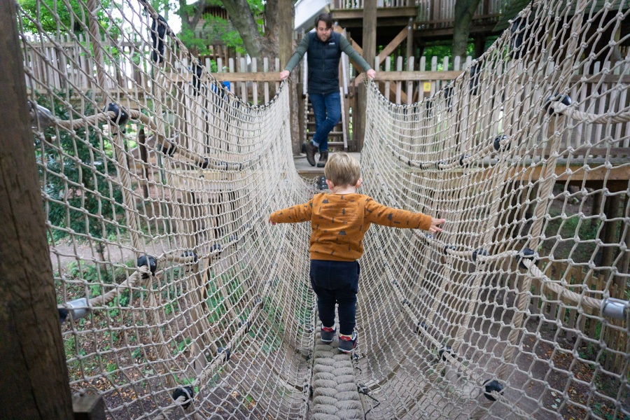 Toddler Crossing over rope bridge