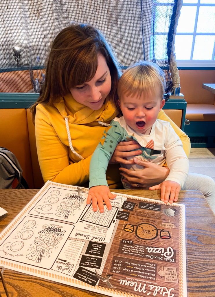 Giaccopazzi's Ice Cream Shop Scottish Borders - Looking at the menu with toddler