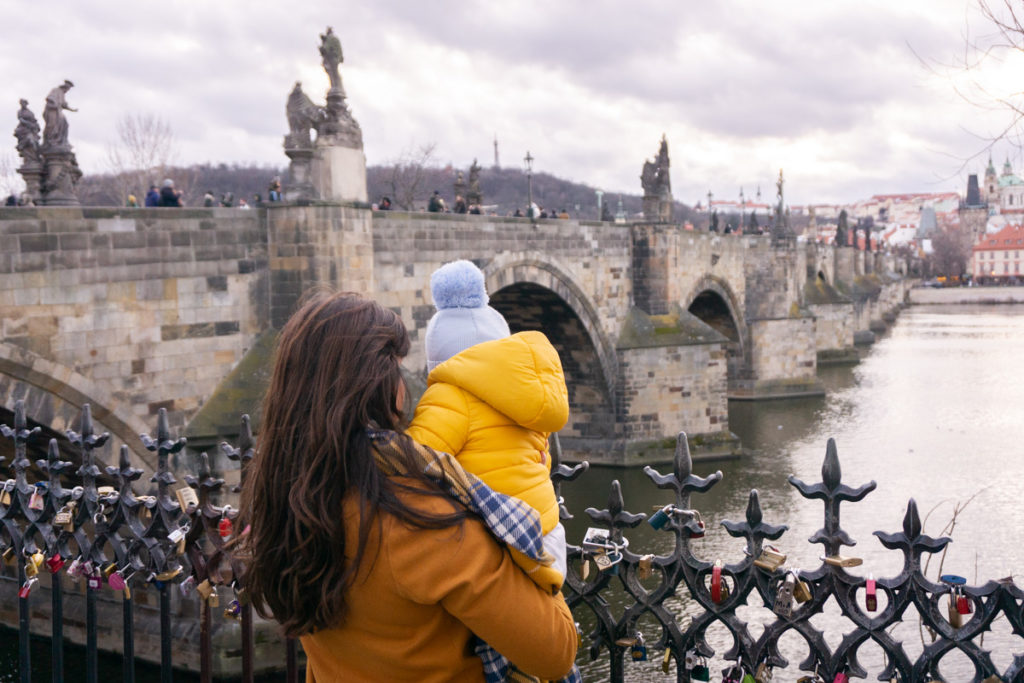 Starting a Business in 2020 - Mum and baby overlooking Charles Bridge in Prague