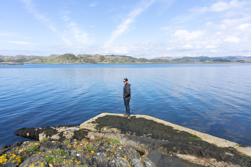 Starting a Business in 2020 - Standing on a rock by the sea at Argyll, Scotland