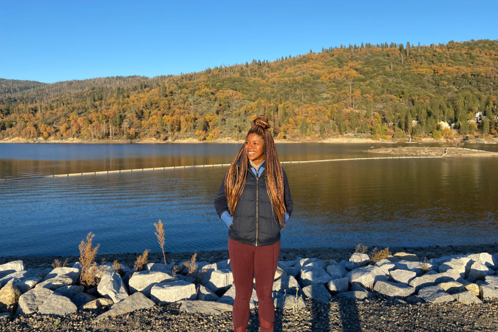 Ciara from Wellness Travel Diaries in front of a lake