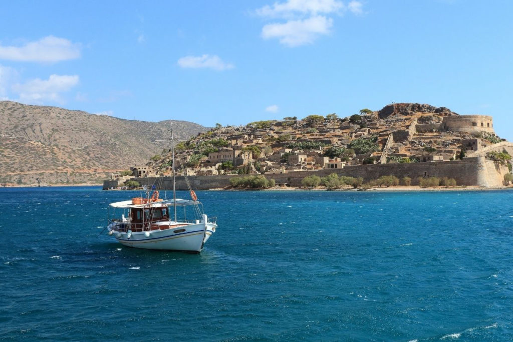 Best Greek Islands for Families - Boat sailing in Crete